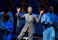 "In this theater image released by Boneau/Bryan-Brown, Raul Esparza is shown during a performance of ""Leap of Faith,"" at the St. James Theatre in New York. (AP Photo/Boneau/Bryan-Brown, Joan Marcus)"