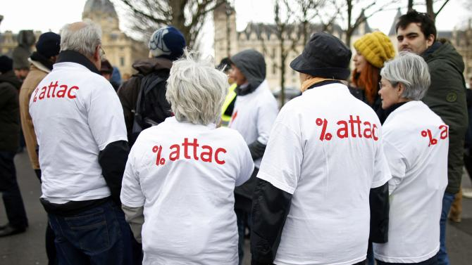 Activists from the anti-globalisation organisation Attac attend a demonstration to protest against the banking system and tax fraud, near the courts in Paris