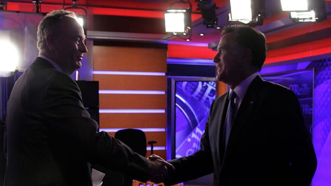 "Republican presidential candidate Mitt Romney, right, shakes hands with Bill O'Reilly after his interview for his Fox News program ""The O'Reilly Factor,"" in New York,  Monday, Dec. 19, 2011. (AP Photo/Richard Drew)"