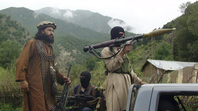 FILE - In this Aug. 5, 2012 file photo, Pakistani Taliban patrol in their stronghold of Shawal in the Pakistani tribal region of South Waziristan. Pakistan has stepped up outreach to some of its biggest enemies in Afghanistan, a significant policy shift that could prove crucial to U.S.-backed efforts to strike a peace deal in the war-torn country.The target of the diplomatic push has mainly been non-Pashtun political leaders who have been at odds with Pakistan for years because of the country's historical support for the Afghan Taliban, a Pashtun movement. (AP Photo/ Ishtiaq Mahsud, File)