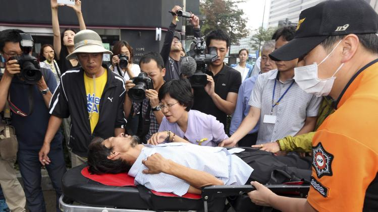 Kim is wheeled to an ambulance on a stretcher after 40 days of fasting in Seoul