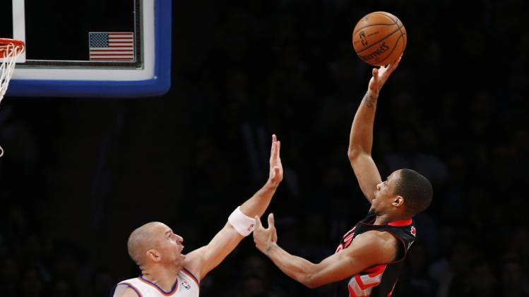 Toronto Raptors' DeRozan shoots over New York Knicks' Kidd during their NBA basketball game in New York