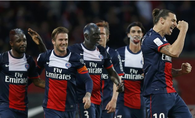 Paris Saint-Germain's Ibrahimovic celebrates with team mates including Beckham after scoring the third goal for the team during their French Ligue 1 soccer match against Brest at the Parc des Princes 