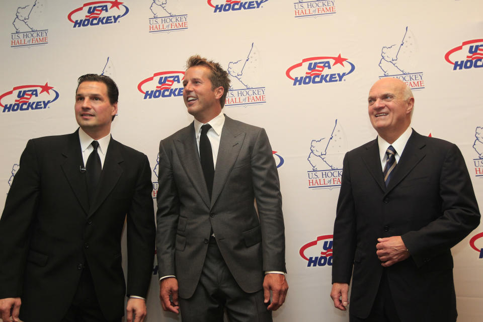 Hockey greats from left, Eddie Olczyk, Mike Modano and Lou Lamoriello gather for a photo before the U.S. Hockey Hall of Fame class of 2012 induction dinner in Dallas, Monday, Oct. 15, 2012. (AP Photo/LM Otero)