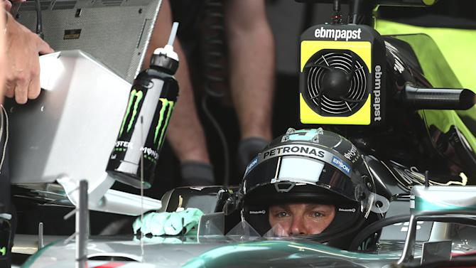 Mercedes Formula One driver Rosberg of Germany sits in his car during the third free practice session at the Monaco F1 Grand Prix