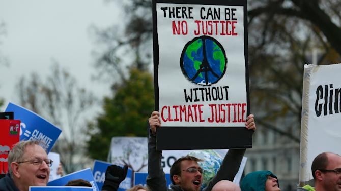 Protesters rally about climate change outside the White House in Washington, DC on November 29, 2015