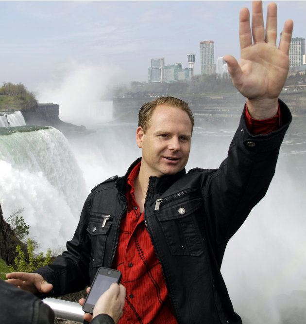 Nik Wallenda waves to tourists after a news conference in Niagara Falls, N.Y., Wednesday, May 2, 2012. Wallenda will try to cross the Niagara Gorge on a tightrope June 15. The seventh-generation membe