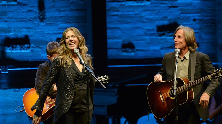 EXCLUSIVE CONTENT - Rita Wilson, left, and Jackson Browne perform on stage during the Backstage at the Geffen gala at the Geffen Playhouse on Monday, May 13, 2013, in Los Angeles. (Photo by Jordan Strauss/Invision for Geffen/AP Images)