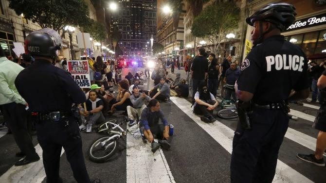 Police face off against protesters as they corral them before making mass arrests in Los Angeles