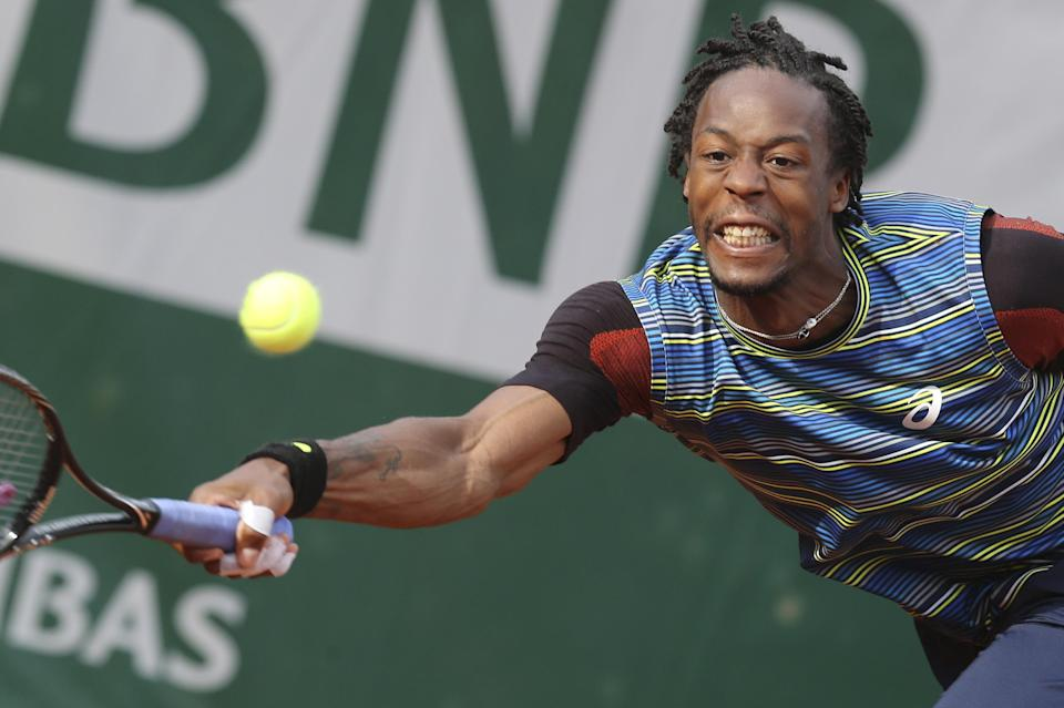 Gael Monfils of France returns against Tomas Berdych of the Czech Republic in their first round match of the French Open tennis tournament, at Roland Garros stadium in Paris, Monday, May 27, 2013. (AP Photo/Michel Euler)