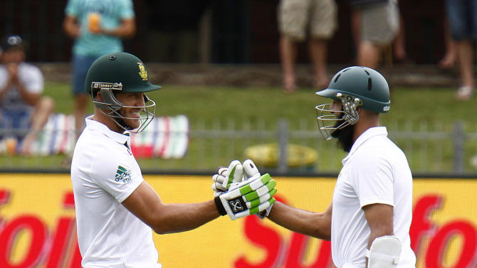 South Africa Faf du Plessis, left, celebrates his century with captain Ashim Amla during the second day of the second test against South Africa  in Port Elizabeth, South Africa, Saturday, Dec. 27, 2014. AP Photo/Michael Sheehan)
