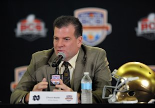 Chuck Martin talks during a press conference as Notre Dame's offensive coordinator. (USA Today)