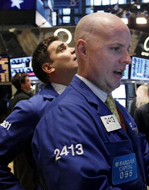 Specialist John J. Ohara works his post on the trading floor of the New York Stock Exchange, Monday, Feb. 13,2012. U.S. stocks rose Monday after Greece's parliament voted for spending cuts so it can get a bailout to save the country from bankruptcy. (AP Photo/David Karp)