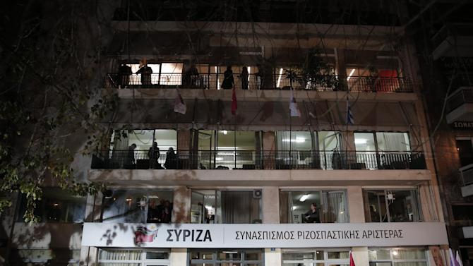 Supporters and media gather outside headquarters of Greece's Syriza left-wing main opposition party in Athens, Sunday, Jan. 25, 2015. Greek election officials say the anti-austerity Syriza party has won Sunday's vote, but it is too soon to say whether it has enough support to form a governing majority. (AP Photo/Lefteris Pitarakis)