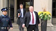 Toronto Mayor Rob Ford leaves court on Nov. 19. The defamation lawsuit against him has been dismissed.