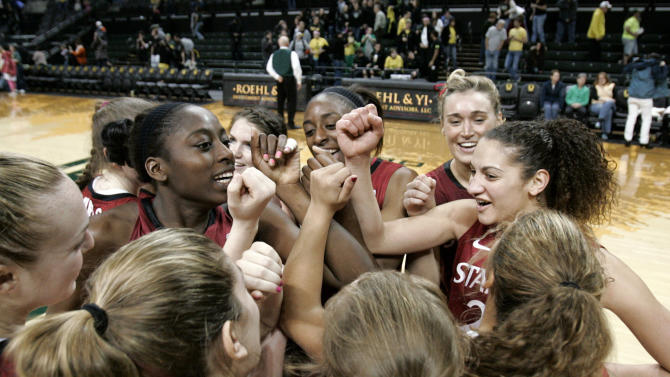 FILE - In this Feb. 18, 2012, file photo, Stanford players, including Chiney Ogwumike, Nnemkadi Ogwumike, Joslyn Tinkle and Erica Payne, from left at middle, gather at center court to celebrate after defeating Oregon an NCAA college basketball game in Eugene, Ore. Stanford and Connecticut have received No. 1 seeds in the women's NCAA tournament. (AP Photo/Chris Pietsch, File)