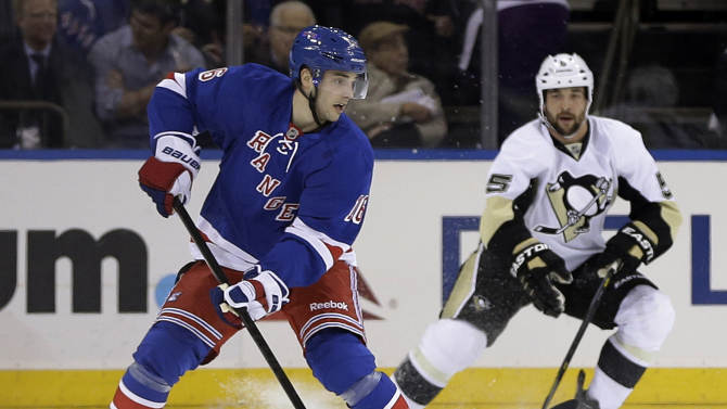 New York Rangers Derick Brassard (16) looks to pass away from Pittsburgh Penguins' Deryk Engelland (5) during the first period of an NHL hockey game, Wednesday, April 3, 2013, in New York. (AP Photo/Frank Franklin II)