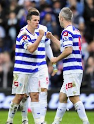 Queens Park Rangers' Joey Barton (L) and Shaun Derry at a Premier League match on March 31. QPR boss Mark Hughes is hoping his side can cause a temporary blip as they look to edge away from the bottom three