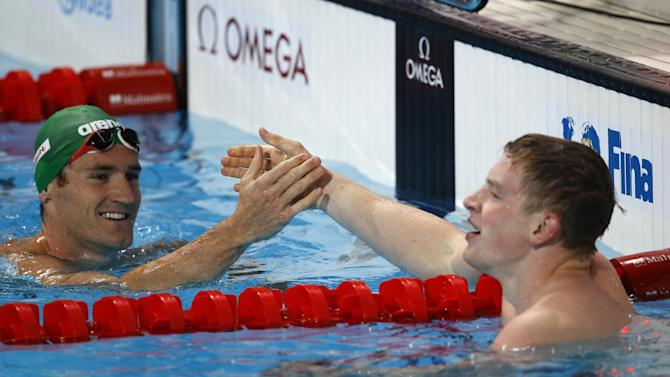 South Africa's silver medal winner Cameron van der Burgh congratulates Britain's gold medal winner Adam Peaty after the men's 100m breaststroke final  at the Swimming World Championships in Kazan, Russia, Monday, Aug. 3, 2015. (AP Photo/Sergei Grits)