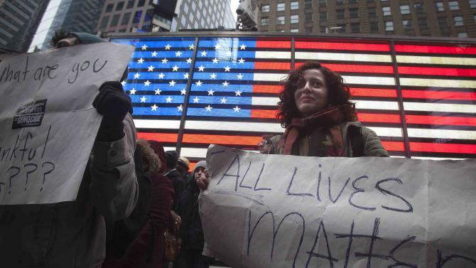 People take part in a demonstration in Times Square