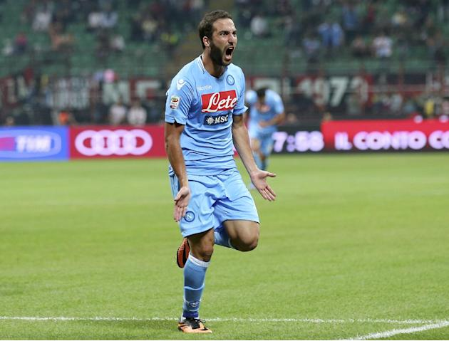 Napoli forward Gonzalo Higuain, of Argentina, celebrates after scoring his side's second goal, during the Serie A soccer match between AC Milan and Napoli at the San Siro stadium in Milan, Italy, Sund