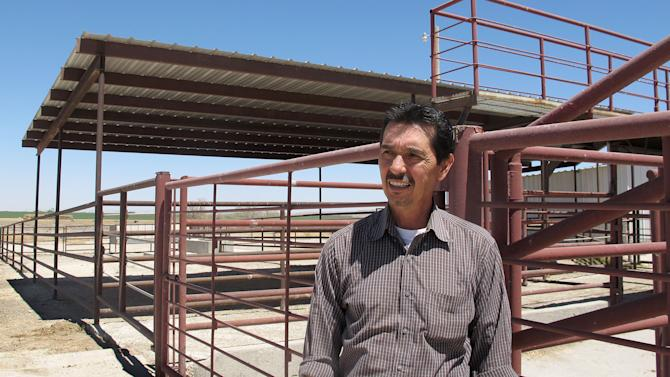 Valley Meat Co. owner Rick De Los Santos stands in a corral area outside the former cattle slaughterhouse he has converted to a horse slaughter facility in Roswell, N.M., Monday, April 15, 2013. The plant --- which has been waiting more than a year for federal approval of its operations -- has become ground zero for an emotional, national debate over a return to domestic horse slaughter. (AP Photo/Jeri Clausing)