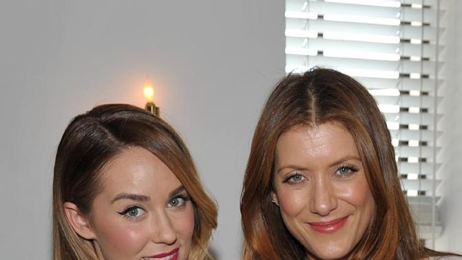 From left, Lauren Conrad and Kate Walsh are seen at the The Hollywood Reporter's Beauty Luncheon held at the Chateau Marmont on Wednesday Nov. 14, 2012 in Los Angeles. (Photo by John Shearer/Invision for THR/AP Images)