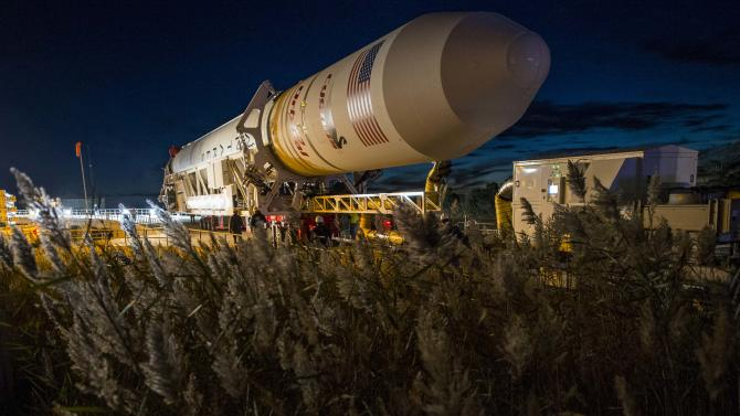 Handout of The Orbital Sciences Corporation Antares rocket, with the Cygnus spacecraft onboard, arrives at launch Pad-0A at NASA's Wallops Flight Facility in Virginia