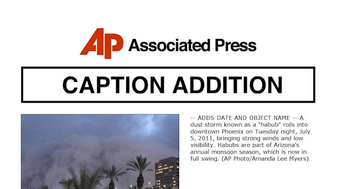 "-- ADDS DATE AND OBJECT NAME -- A dust storm known as a ""habub"" rolls into downtown Phoenix on Tuesday night, July 5, 2011, bringing strong winds and low visibility. Habubs are part of Arizona's annual monsoon season, which is now in full swing. (AP Photo/Amanda Lee Myers)"