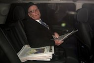 News Corporation Chief Rupert Murdoch leaves his London home on February 17. Murdoch&#39;s Australian arm News Limited on Wednesday made an Aus$1.97 billion takeover bid for media investment firm Consolidated Media Holdings