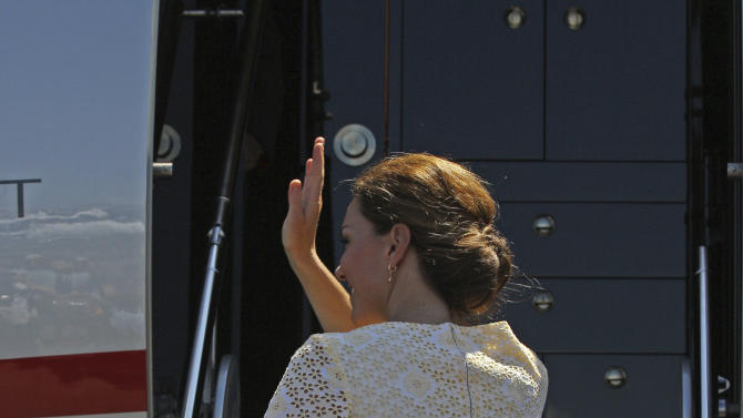 Britain's Prince William, bottom, and his wife Kate, the Duke and Duchess of Cambridge, board their plane to depart Honiara, Solomon Islands, Tuesday, Sept. 18, 2012, after an official visit to the South Pacific Island nation.  (AP Photo/Rick Rycroft)