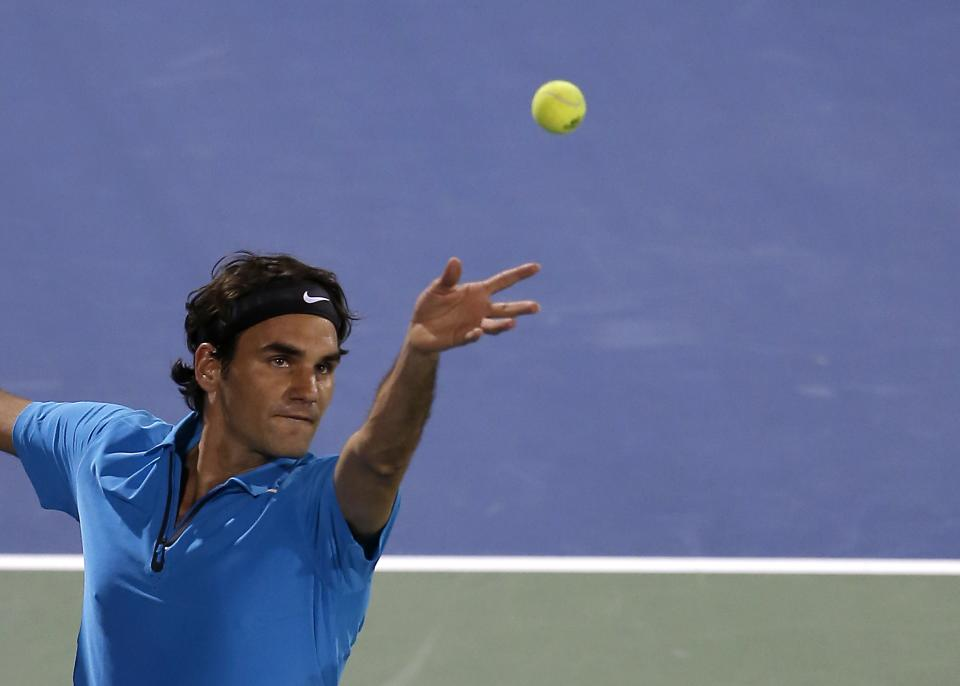 Roger Federer of Switzerland serves to Tomas Berdych of the Czech Republic during the semi-finals of the Dubai Duty Free Tennis Championships in Dubai, United Arab Emirates, Monday, March 1, 2013. (AP Photo/Regi Varghese)