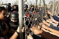 Relatives of inmates at Apodaca prison pull the security fence following a riot inside the prison near Monterrey, state of Nuevo Leon, Mexico. At least 44 inmates were killed in a Mexican prison riot on Sunday, just days after a deadly inferno in a jail in Honduras, again highlighting terrible overcrowding in Latin American prisons
