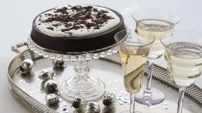 In this image taken on Nov. 26, 2012, a flourless chocolate cake is shown served on a cake stand in Concord, N.H. (AP Photo/Matthew Mead)