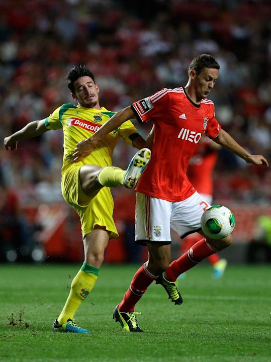 Benfica's Nemanja Matic, from Serbia, right, controls the ball past Pacos de Ferreira's Romeu Rocha during their Portuguese league soccer match Saturday, Sept. 14, 2013, at Benfica's Luz stadium in Li