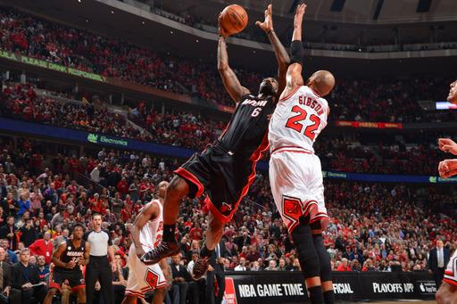 James, Bosh lead Heat past Bulls, 104-94