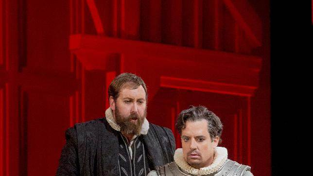 """In this Dec. 24, 2012 photo provided by the Metropolitan Opera, Matthew Rose is Talbot and Matthew Polenzani plays Leicester in Donizetti's """"Maria Stuarda,"""" during a dress rehearsal of Donizetti's """"Maria Stuarda,"""" at the Metropolitan Opera in New York. (AP Photo/Metropolitan Opera, Ken Howard)"""