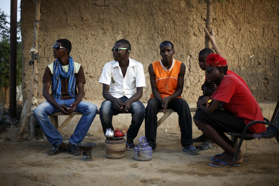 Smartly dressed and wearing fashionable sunglasses, high school students hangout on the eve of schools reopening in Gao, northern Mali, Sunday Feb. 17, 2013.  (AP Photo/Jerome Delay)