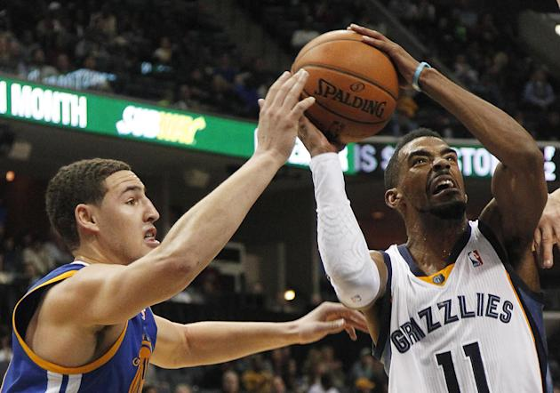 Golden State guard Klay Thompson (11) tries to block a shot by Memphis Grizzlies guard Mike Conley (11) in the second half of an NBA basketball game Saturday, Dec. 7, 2013, in Memphis, Tenn. Golden St