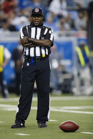 "FILE - In this Thursday, Nov. 22, 2012 file photo, umpire Roy Ellison (81) waits in between plays during an NFL football game between the Detroit Lions and the Houston Texans at Ford Field in Detroit. Ellison, an NFL game official was suspended Friday, Nov. 22, 2013 for one game without pay for making ""a profane and derogatory statement"" to a Washington Redskins player, an incident that has led to a call for NFL players to stop using the N-word on the field and in the locker room. (AP Photo/Rick Osentoski, File)"