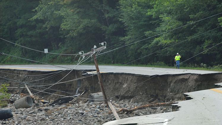Route 4 in Mendon, Vt. is damaged as work crews evaluate their next move after Hurricane Irene on Monday, Aug 29, 2011. The highway is in between Rutland, Vt., and Killington, Vt.  (AP Photo/The Daily Herald, Vyto Starinskas)