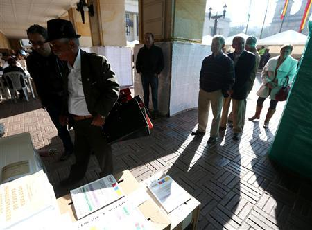 Colombians wait in line to vote during the opening of the congressional elections in Bogota