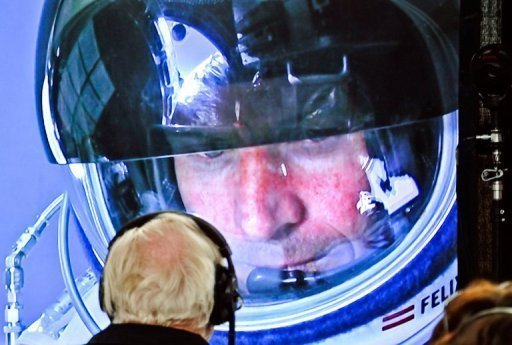 Felix Baumgartner is seen in his capsule on a screen at mission control before jumping in this photo from Red Bull