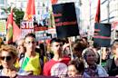 Members of Berlin's Turkish and Kurdish community march to protest against the military coup in Turkey on July 22