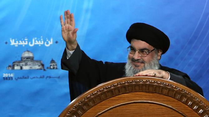 """Hezbollah leader Sheik Hassan Nasrallah speaks during a rally to mark Jerusalem Day or Al-Quds day, in the southern suburb of Beirut, Lebanon, Friday, July 25, 2014. Nasrallah said that the """"resistance"""" in Gaza became victorious after the Zionists and all their backers worldwide failed in achieving any of their goals. (AP Photo/Bilal Hussein)"""