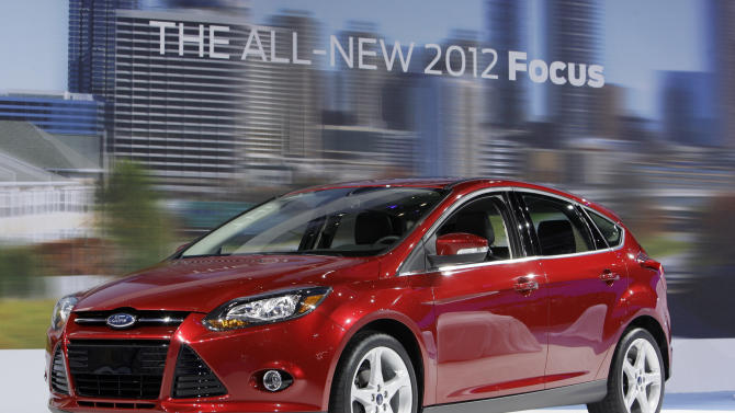 FILE - This Wednesday, Nov. 17, 2010 file picture shows the 2012 model year Ford Focus during its debut at the LA Auto Show in Los Angeles. Ford Motor Co. said Friday Aug. 31, 2012 its Focus small car is on track to become the best-selling car in the world this year, trumping the Toyota Corolla.(AP Photo/Reed Saxon, File)