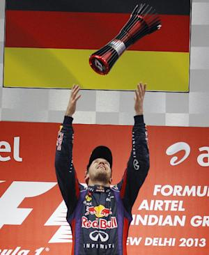 Vettel: No easing up after clinching F1 title