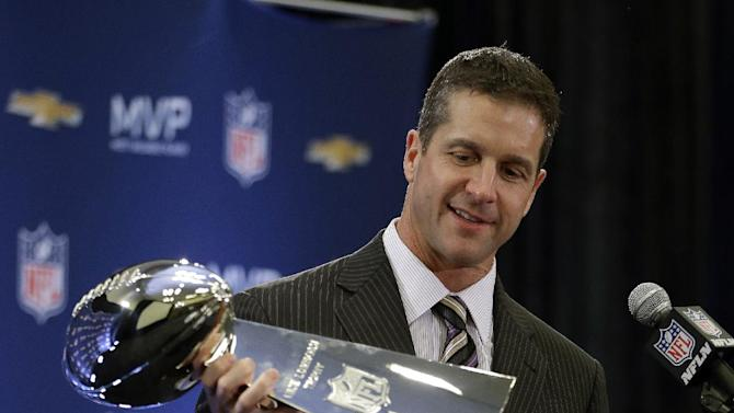 Baltimore Ravens head coach John Harbaugh holds the Vince Lombardi Trophy during a news conference after NFL Super Bowl XLVII football game Monday, Feb. 4, 2013, in New Orleans. The Ravens defeated the San Francisco 49ers 34-31.(AP Photo/Darron Cummings)