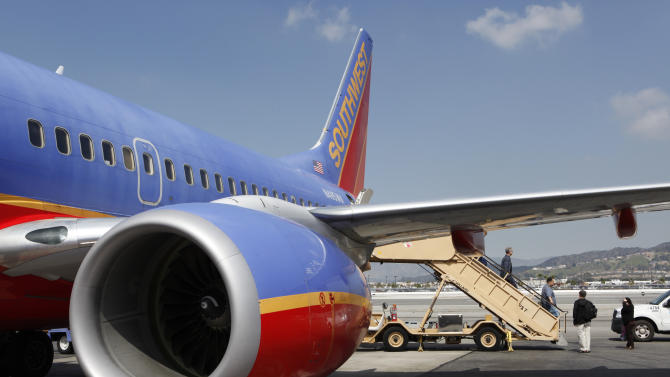 This March 13, 2010 photo, shows a Southwest Airlines plane in Burbank, Calif. Southwest Airlines Co. reports quarterly financial results before the market open on Thursday, April 25, 2013. (AP Photo/Paul Sakuma)