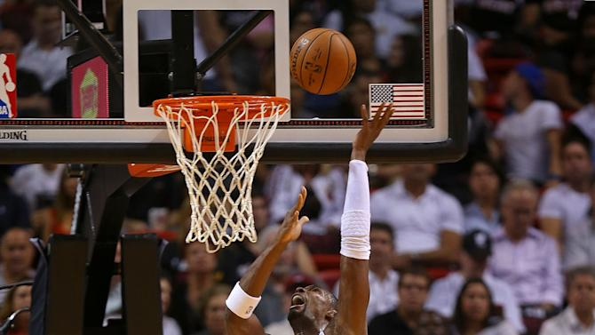 Heat open new era, top Wizards 107-95 in opener